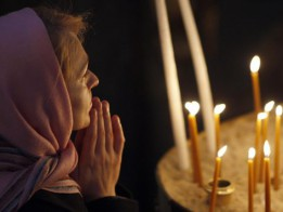A woman prays during a Christmas mass in Aya Yorgi (St. George) church at Fener Greek orthodox patriarchate in Istanbul